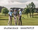 multiethnic group of golfers... | Shutterstock . vector #666696919