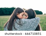 two women are hugging on the... | Shutterstock . vector #666710851