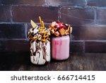 raspberry extreme milkshakes... | Shutterstock . vector #666714415
