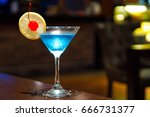 Blue kamikaze cocktail on wooden table