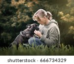 Stock photo the girl talks to the dog nature green grass beautiful 666734329