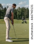 young casual man playing golf... | Shutterstock . vector #666740131