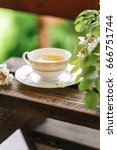 a cup of tea and a saucer on... | Shutterstock . vector #666751744