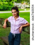beautiful young woman outdoor... | Shutterstock . vector #666760054