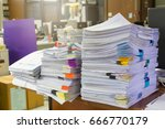 pile of unfinished documents on ... | Shutterstock . vector #666770179