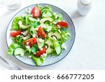 green salad with sliced avocado ... | Shutterstock . vector #666777205