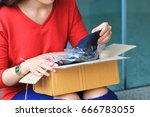 young woman opening box with... | Shutterstock . vector #666783055