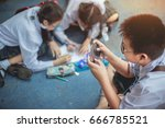 boys playing games on mobile... | Shutterstock . vector #666785521