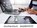 designer  working at office.... | Shutterstock . vector #666804535