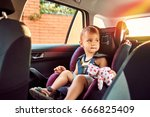 adorable baby in safety car... | Shutterstock . vector #666825409
