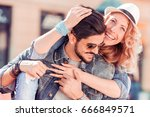 happy young couple having fun... | Shutterstock . vector #666849571