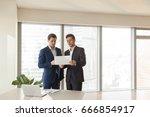 two serious businessmen... | Shutterstock . vector #666854917