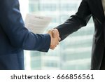 businessmen handshaking  male...   Shutterstock . vector #666856561