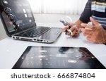 designer  working at office.... | Shutterstock . vector #666874804