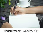 business woman writing with pen ... | Shutterstock . vector #666892741