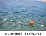 floating orange buoys inform... | Shutterstock . vector #666901465