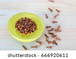 Small photo of Dry cloves in green bowl. Cloves have Aphrodisiac Properties.