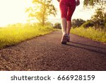 a woman with an athletic pair... | Shutterstock . vector #666928159