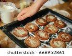 hands cut cookie from raw dough ... | Shutterstock . vector #666952861