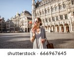 young woman walking with waffle ... | Shutterstock . vector #666967645