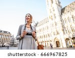 young female tourist standing... | Shutterstock . vector #666967825