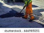 worker leveling fresh asphalt...   Shutterstock . vector #666985051