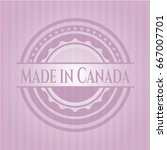 made in canada badge with pink... | Shutterstock .eps vector #667007701