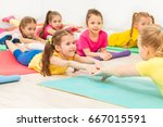 kids practicing gymnastics with ... | Shutterstock . vector #667015591