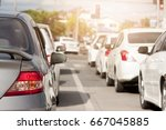 cars on the road heading... | Shutterstock . vector #667045885