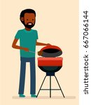 man is cooking a barbecue grill....   Shutterstock .eps vector #667066144