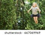 Little child blond girl having...