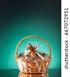 gift basket on emerald... | Shutterstock . vector #667072951