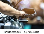 human hand in a motorcycle... | Shutterstock . vector #667086385