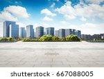 asphalt road and modern city | Shutterstock . vector #667088005
