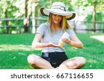 young woman a bottle of... | Shutterstock . vector #667116655
