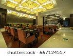 hotel restaurant interior. | Shutterstock . vector #667124557