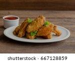 thai style homemade deep fried...   Shutterstock . vector #667128859