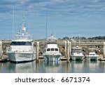Four Boats In A Marina In Orde...