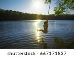 Boy Bungee Jumping Over Water....