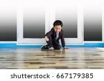 Small photo of Little Asian businessman try to stand up after fall down: concept of trying standing from business failed
