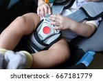 baby child sitting in car seat... | Shutterstock . vector #667181779