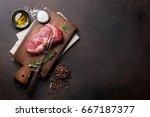 raw ribeye beef steak cooking...   Shutterstock . vector #667187377