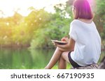 young woman writing on notebook ... | Shutterstock . vector #667190935
