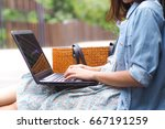 female hands typing on a laptop ... | Shutterstock . vector #667191259