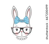 cute bunny girl with glasses ... | Shutterstock .eps vector #667200499