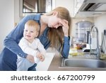tired mom with baby in her arms ... | Shutterstock . vector #667200799
