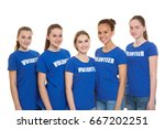 Small photo of Group of young volunteers on white background