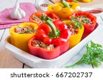 red and yellow stuffed peppers | Shutterstock . vector #667202737