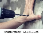 drill in the hands of security. ... | Shutterstock . vector #667213225