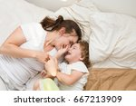 mother with her little son... | Shutterstock . vector #667213909